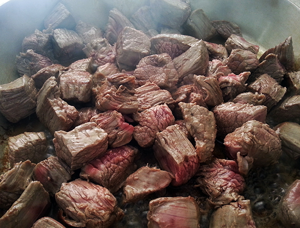 Skirt steak browning in skillet